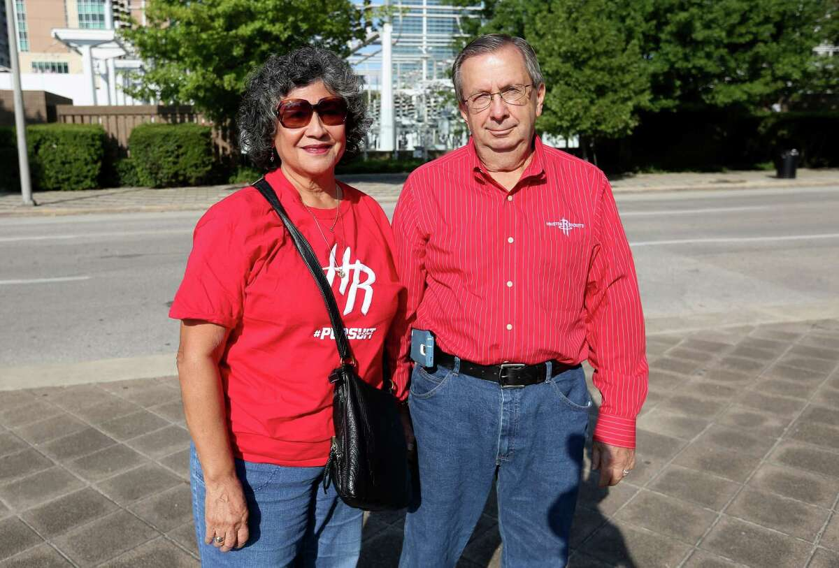Houston Rockets fans pose for a photo outside of Toyota Center before the game between the Rockets and Shanghai Sharks Sunday, Oct. 2, 2016, in Houston.