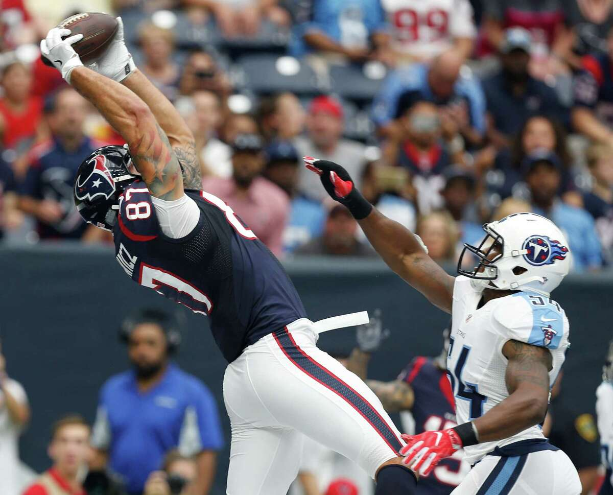 Houston Texans tight end C.J. Fiedorowicz (87) beats Tennessee Titans lienbacker Avery Williamson (54) for a 14-yard touchdown reception during the first quarter of an NFL football game at NRG Stadium on Sunday, Oct. 2, 2016, in Houston.