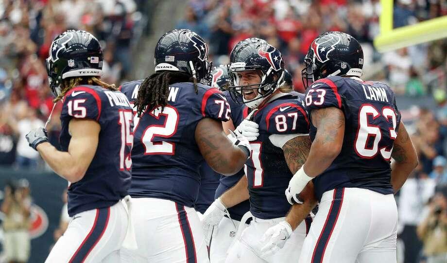 Houston Texans tight end C.J. Fiedorowicz (87) celebrates his touchdown during the first quarter of an NFL football game at NRG Stadium, Sunday, Oct. 2, 2016 in Houston. Photo: Karen Warren, Houston Chronicle / 2016 Houston Chronicle