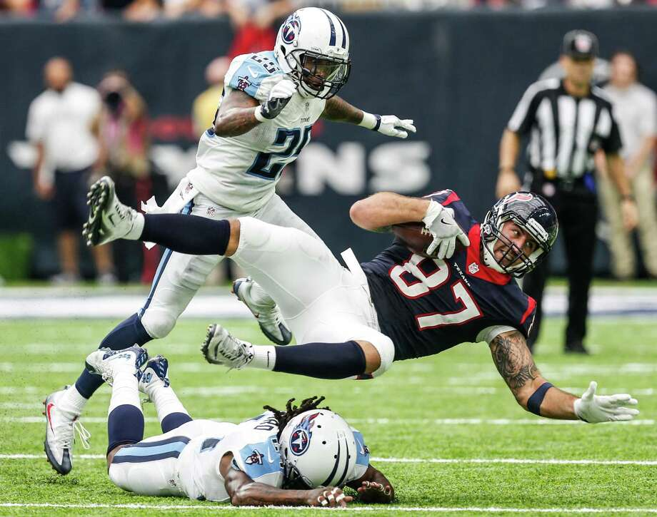 Houston Texans tight end C.J. Fiedorowicz (87) is tripped up by Tennessee Titans free safety Daimion Stafford (24) and Rashad Johnson (25) on an 18-yard reception during the second quarter of an NFL football game at NRG Stadium on Sunday, Oct. 2, 2016, in Houston. Photo: Brett Coomer, Houston Chronicle / © 2016 Houston Chronicle