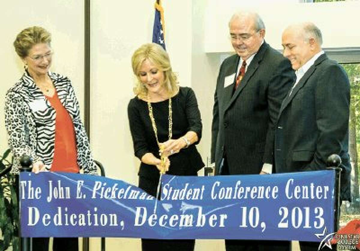 Lone Star College-Kingwood recently dedicated and renamed its conference center to the John E. Pickelman Student-Conference Center. Pictured left to right are Dr. Katherine Persson, LSC-Kingwood president; Stephanie Marquard, LSCS board trustee; Dr. Pickleman; and Dr. Richard Carpenter, LSCS chancellor.