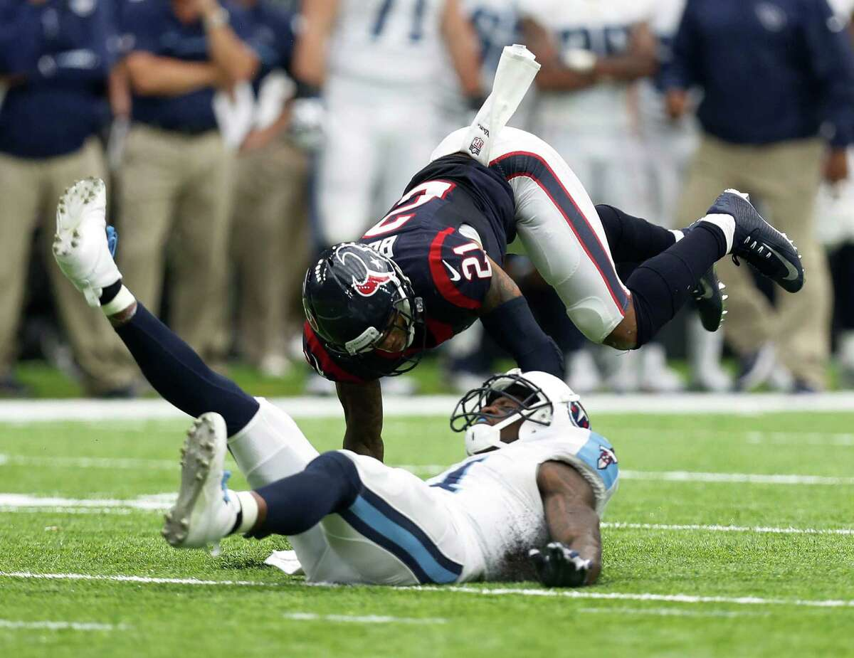 Houston Texans cornerback A.J. Bouye (21) flies over Tennessee Titans wide receiver Andre Johnson (81) as he broke up a pass play during the fourth quarter of an NFL football game at NRG Stadium, Sunday, Oct. 2, 2016 in Houston.