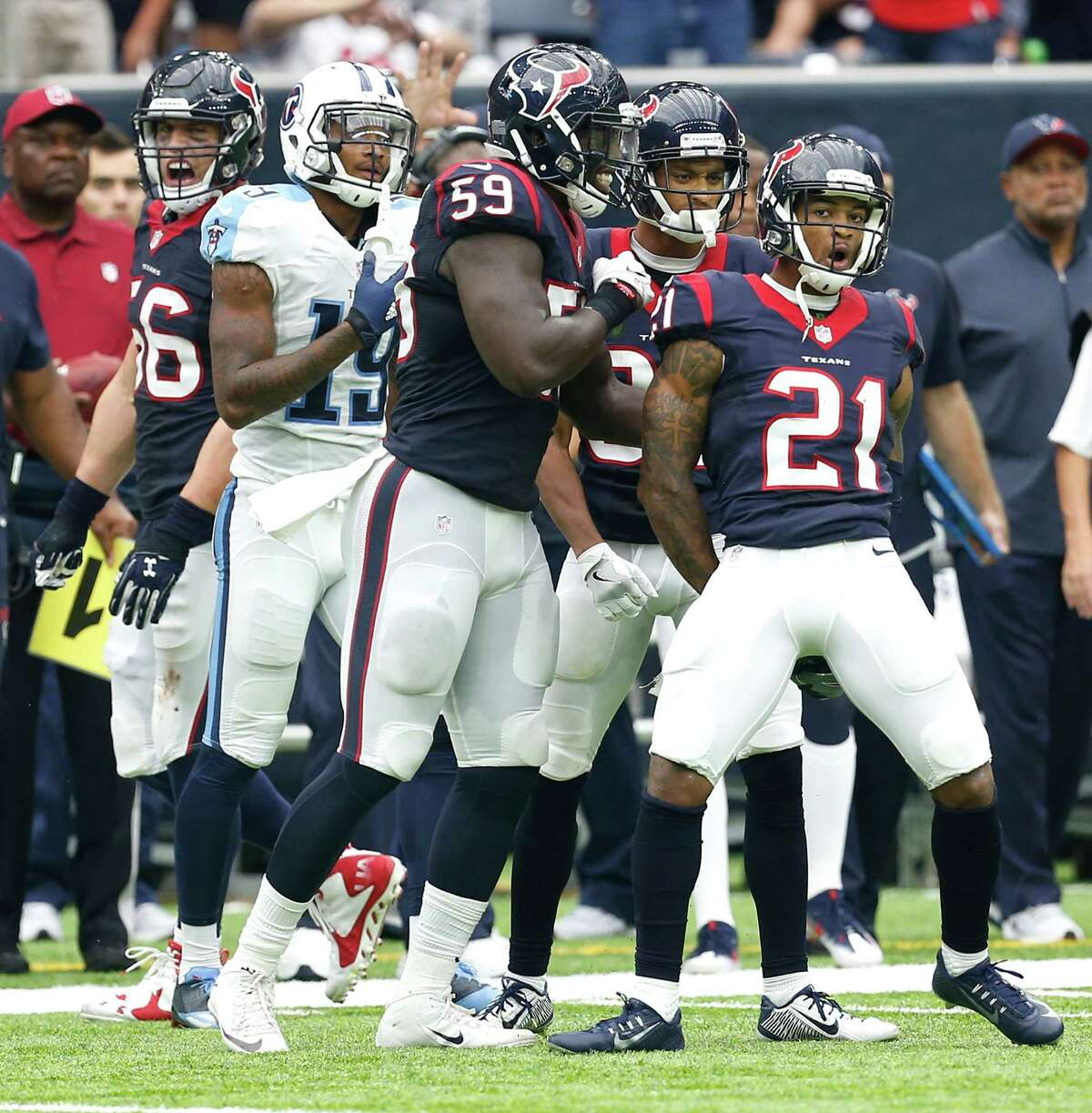 Houston Texans cornerback A.J. Bouye (21) and outside linebacker Whitney Mercilus (59) react after stopping the Tennessee Titans short of a first down during the fourth quarter of an NFL football game at NRG Stadium on Sunday, Oct. 2, 2016, in Houston.