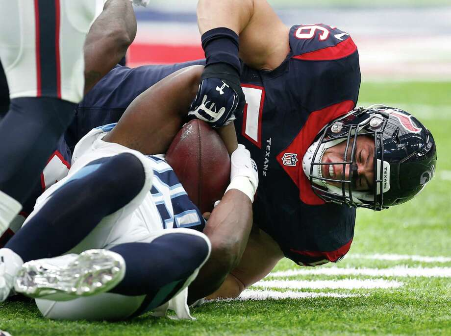 Houston Texans linebacker Brian Cushing tackles Tennessee Titans running back DeMarco Murray (29) during the first quarter of an NFL football game at NRG Stadium on Sunday, Oct. 2, 2016, in Houston. Photo: Brett Coomer, Houston Chronicle / © 2016 Houston Chronicle