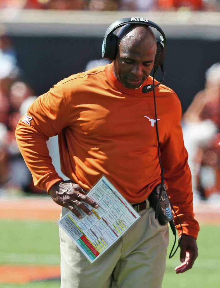 Texas coach Charlie Strong is squarely on the hot seat after Saturday's loss to Oklahoma State dropped the Longhorns to 2-2 and out of the Top 25. Photo: Sue Ogrocki, STF / AP2016