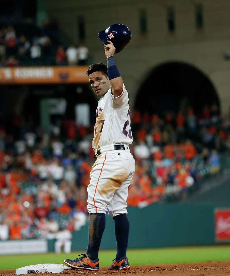 En route to winning the AL batting title with a .338 average, Jose Altuve celebrated his 1,000th career hit in an August game at Minute Maid Park. Photo: Karen Warren, Staff / © 2016 Houston Chronicle