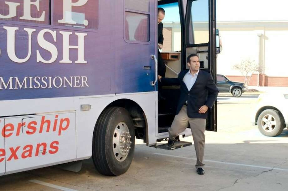 Texas Land Commissioner candidate George P. Bush steps off his campaign bus as he kicks off his campaign tour at the South East Harris County Republican Headquarters in Pasadena Tuesday, Jan. 14. Photo: KIRK SIDES