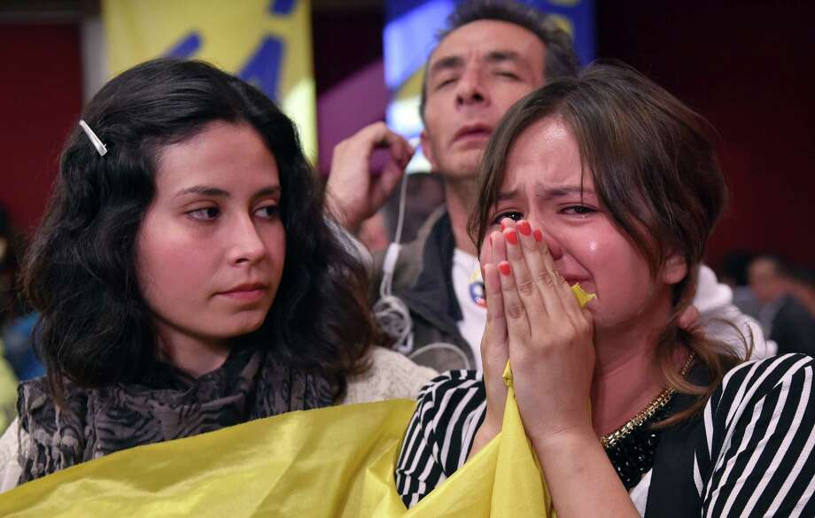 A woman cries on Sunday after learning the referendum on whether to ratify a historic peace accord to end a 52-year war in Colombia has failed. Photo: GUILLERMO LEGARIA, Stringer / AFP or licensors
