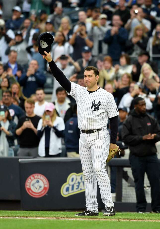 New York Yankees first baseman Mark Teixeira waves to fans as he leaves a baseball game against the Baltimore Orioles on Oct. 2, 2016. Teixeira is retiring after the game.Scroll through to peek inside his Dallas-area home now on the auction block Photo: Kathy Kmonicek / FR170189 AP