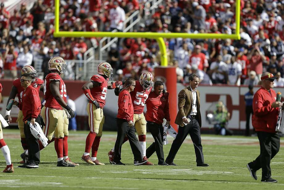 San Francisco 49ers linebacker NaVorro Bowman (53) is helped off the field during the second half of an NFL football game against the Dallas Cowboys in Santa Clara, Calif., Sunday, Oct. 2, 2016. (AP Photo/Ben Margot) Photo: Ben Margot, Associated Press