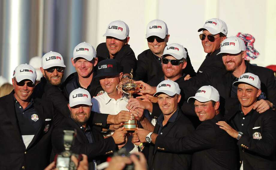 The U.S. Ryder Cup team poses with the Ryder Cup during the closing ceremonies on Sunday, Oct. 2, 2016 at the conclusion of 2016 Ryder Cup at the Hazeltine National Golf Club in Chaska, Minn. (Leila Navidi/Minneapolis Star Tribune/TNS) Photo: Leila Navidi, MBR / Minneapolis Star Tribune