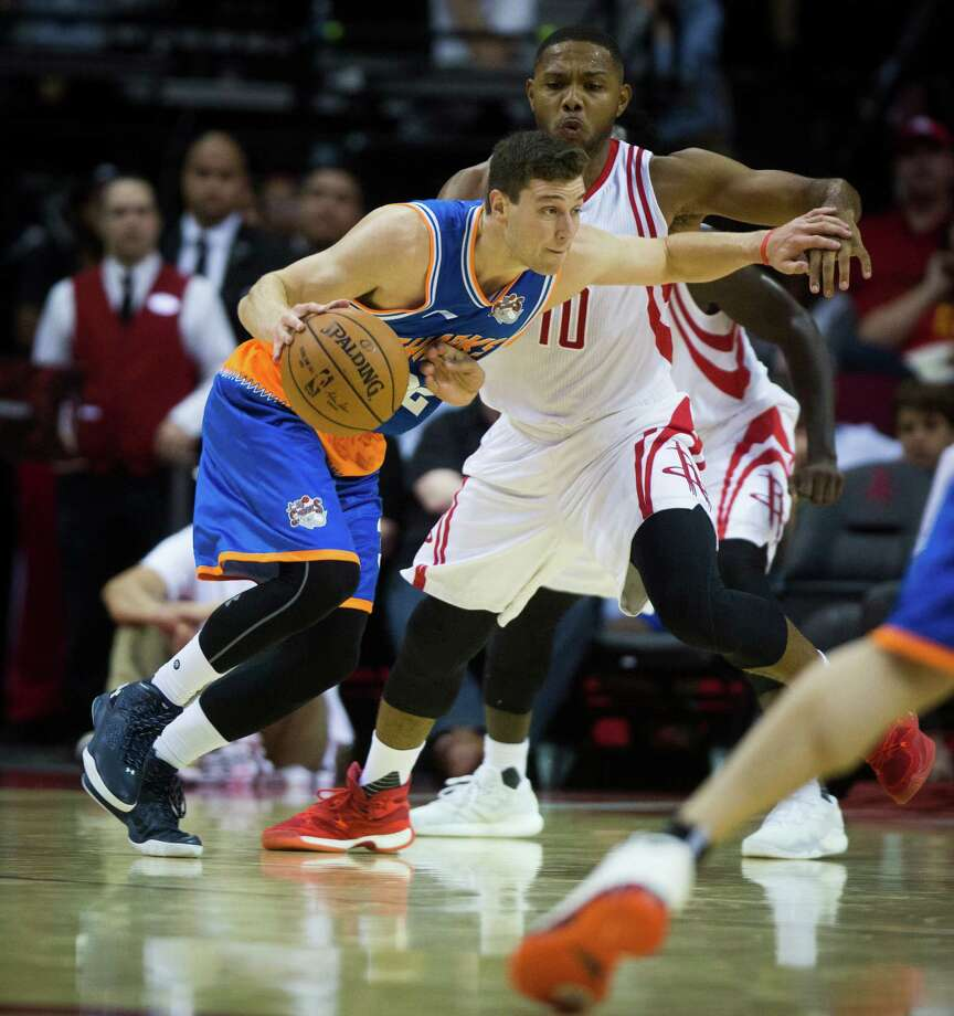 Shanghai Sharks guard Jimmer Fredette drives to the basket against Houston Rockets guard Eric Gordon (10) during the preseason opener, Sunday, Oct. 2, 2016, at the Toyota Center in Houston. ( Marie D. De Jesus / Houston Chronicle ) Photo: Marie D. De Jesus, Staff / © 2016 Houston Chronicle