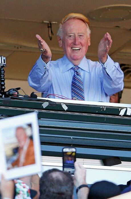 Los Angeles Dodgers' legendary announcer Vin Scully acknowledges the crowd during 7th inning stretch in Scully's final regular season broadcast during Dodgers' MLB game against San Francisco Giants at AT&T Park in San Francisco, Calif., on Sunday, October 2, 2016. Photo: Scott Strazzante, Staff Photographer / **MANDATORY CREDIT FOR PHOTOG AND SF CHRONICLE/NO SALES/MAGS OUT/TV