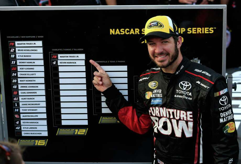 DOVER, DE - OCTOBER 02:  Martin Truex Jr., driver of the #78 Furniture Row/Denver Mattress Toyota, poses with the Sprint Cup Chase grid board after winning the NASCAR Sprint Cup Series Citizen Solider 400 at Dover International Speedway on October 2, 2016 in Dover, Delaware.  (Photo by Chris Trotman/Getty Images) Photo: Chris Trotman, Stringer / 2016 Getty Images