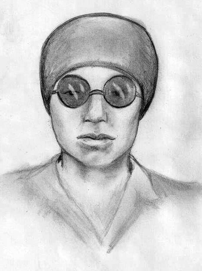 A sketch of one of the suspects being sought for commiting a brazen robbery in Sugar Land while posing as a waterline repair crew. The female suspect was described as petite and possibly white, wearing a head covering and sunglasses, aqua-colored clothing and blue gloves. Photo: Courtesy City Of Sugar Land