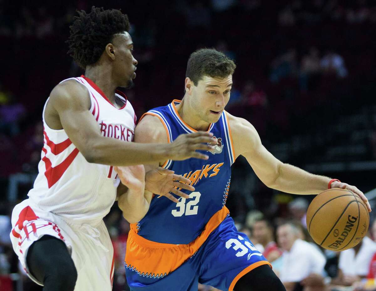 Shanghai Sharks guard Jimmer Fredette drives by Houston Rockets guard Isaiah Taylor (17) on his way to the basket during the second half of the game between Shanghai and Houston, Sunday, Oct. 2, 2016, in Houston. The Rockets won 131-94.