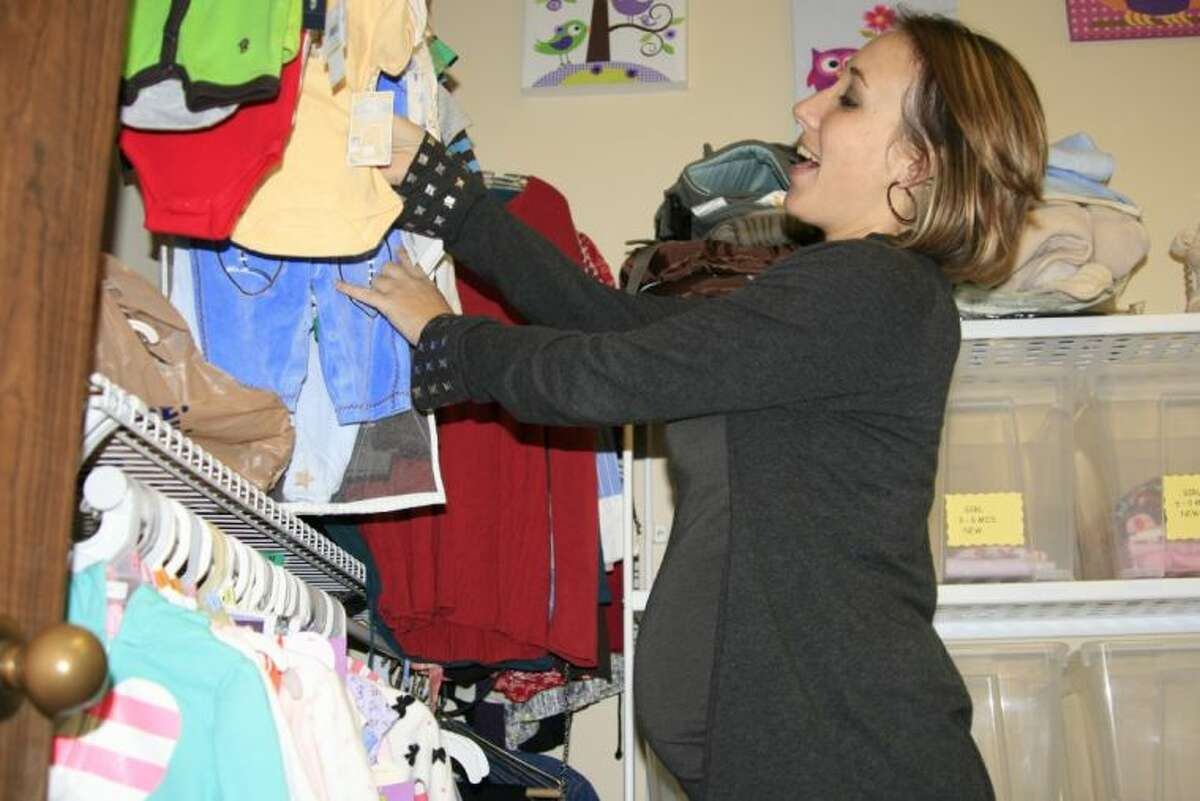 Erin Stubbs peruses the racks of baby clothes at the Alpha Pregnancy Center located in Humble.