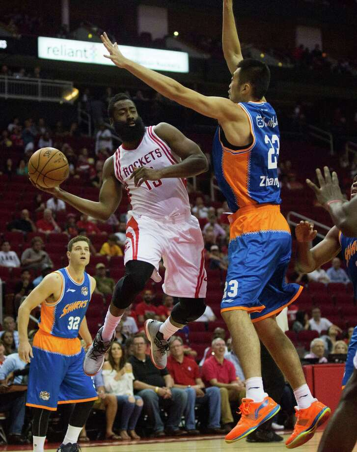 Houston Rockets guard James Harden (13) makes a pass against Shanghai Sharks forward Zhai Yi, right, at the Toyota Center, Sunday, Oct. 2, 2016, in Houston. The Houston Rockets won 131-94. Photo: Marie D. De Jesus, Houston Chronicle / © 2016 Houston Chronicle