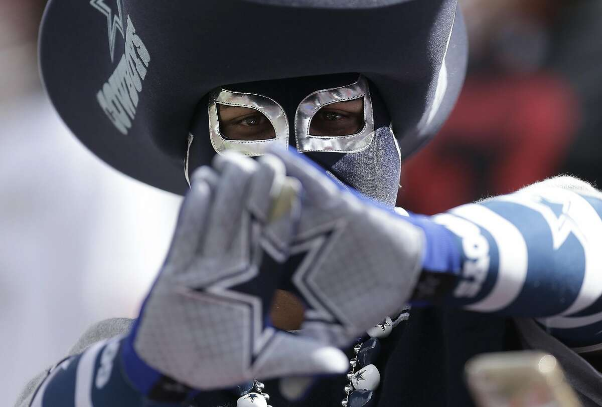A Dallas Cowboys fan gestures before an NFL football game between the San Francisco 49ers and the Dallas Cowboys in Santa Clara, Calif., Sunday, Oct. 2, 2016.