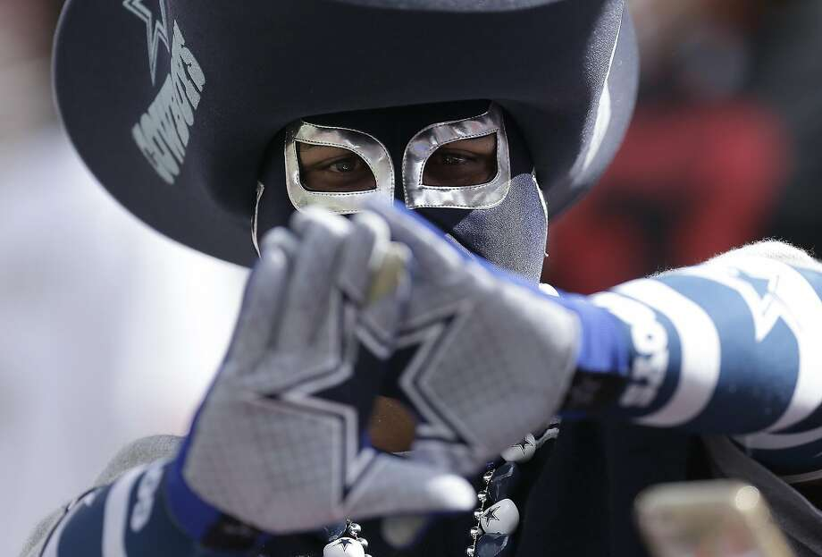 A Dallas Cowboys fan gestures before an NFL football game between the San Francisco 49ers and the Dallas Cowboys in Santa Clara, Calif., Sunday, Oct. 2, 2016.  Photo: Ben Margot, Associated Press