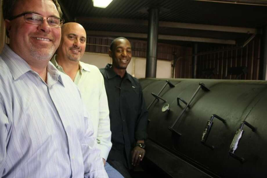 Owner Darrin Winner, Owner Richard Moro and General Manager Steve Haley worked with the city for months before opening to make sure their one-of-a-kind pit and smoke house was up to city code.