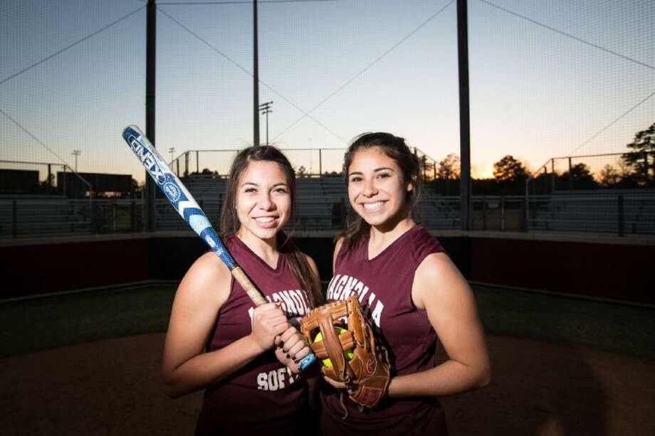 Magnolia senior Emily Garza, left, and junior Hailey Garza, right, are pictured on Friday, Jan. 17, 2014, at the Magnolia High School softball field. Both of the Garza sisters have committed to going to the University of Texas at San Antonio to play softball after graduating from Magnolia. (Michael Minasi / HCN) Photo: Michael Minasi