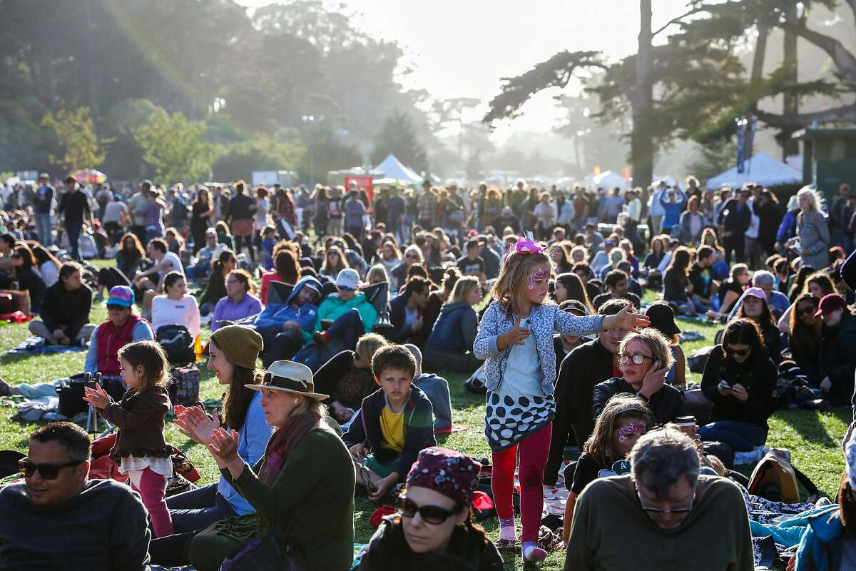 Thousands of people gather to listen to music at the Hardly Strictly Bluegrass music festival in Golden Gate Park in San Francisco, California, on Sunday, Oct. 2, 2016.