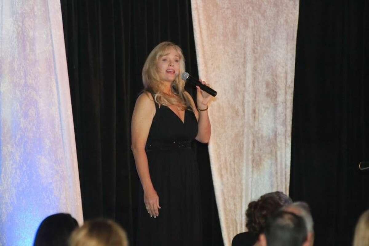 Shari Wilkins performs during the Bay Area Houston Economic Partnership annual Quasar award banquet Friday, Jan. 17.