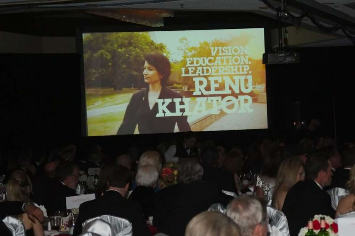 Guests enjoy a video presentation honoring 2014 Quasar award recipient University of Houston System Chancellor Dr. Renu Khator during the BAHEP annual award banquet Friday, Jan. 17.