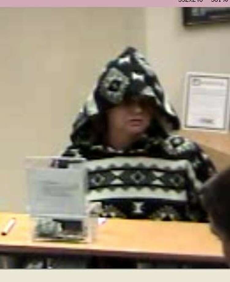 The FBI is releasing photographs of an older woman who has now robbed the same Kingwood bank branch twice this month.