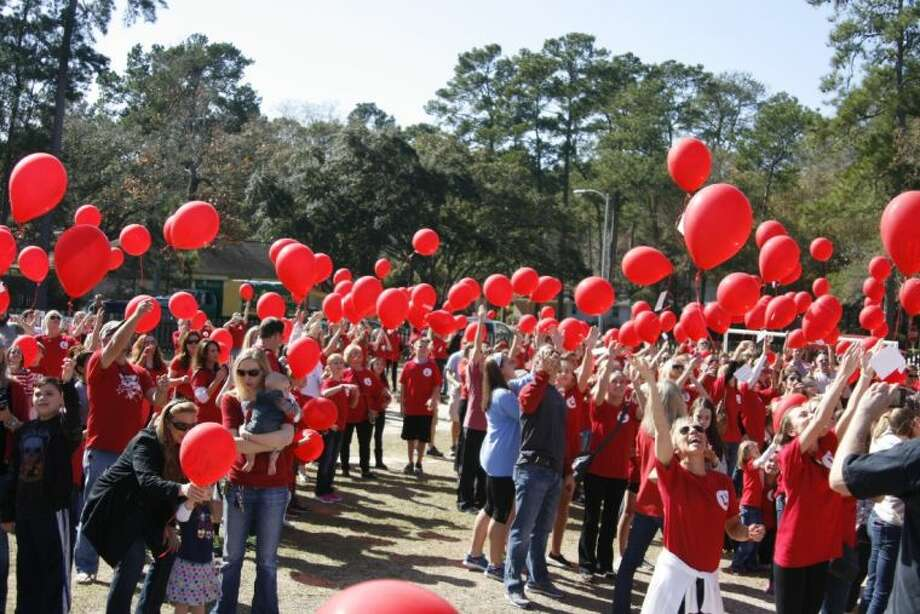 The balloon release event was a collaboration of residents and friends of the Ahrendt family who wanted to gather to pray for Landon, lift up their prayers with a balloon release and enjoy a meal at the playground at Foster Elementary Jan. 20, 2014.