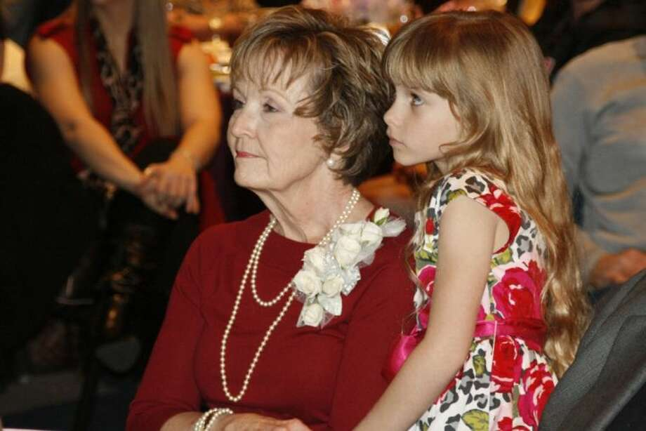 Lynette Calfee with granddaughter, Baylee, was recognized as the recipient of the 2013 Haden McKay, MD Citizen of the Year at the Lake Houston Area Chamber of Commerce's annual awards luncheon Jan. 21, 2014.