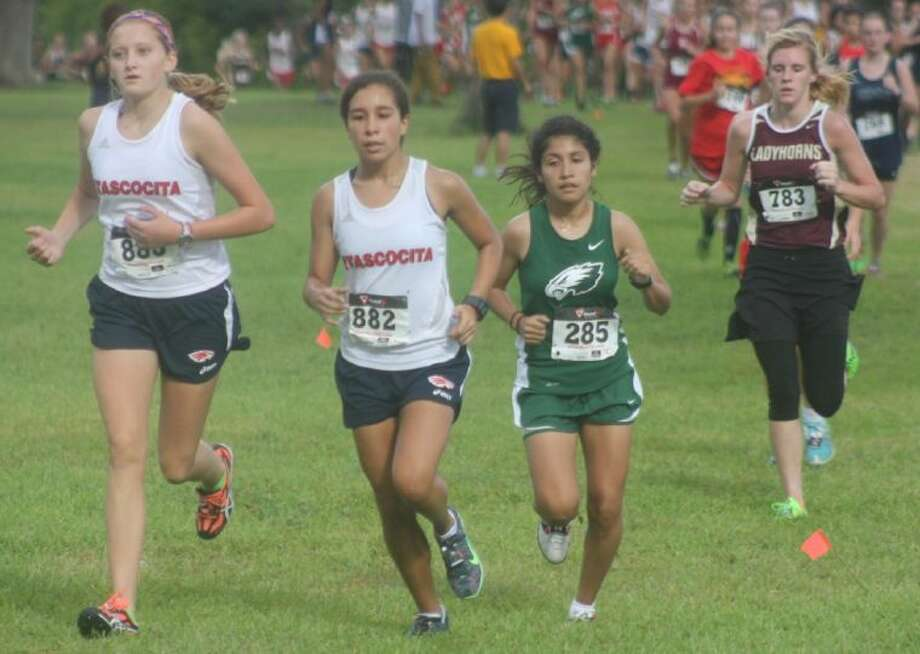Pasadena's Emely Morgado (in green), shown in an earlier race this season, will be trying to spark the Lady Eagles to a team berth to the Region III run this morning and possibly upsetting defending champ Manvel. Photo: Robert Avery
