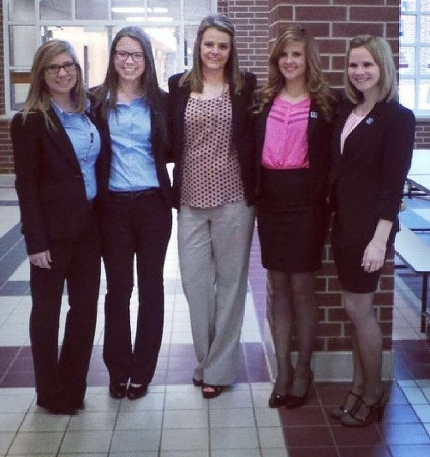 Splendora DECA students Morgan Wisenbaker, Emily Shaw, Advisor Kim Grider, Becca Smith and Megan Peck recently competed at their District Career Development Conference Jan. 18.