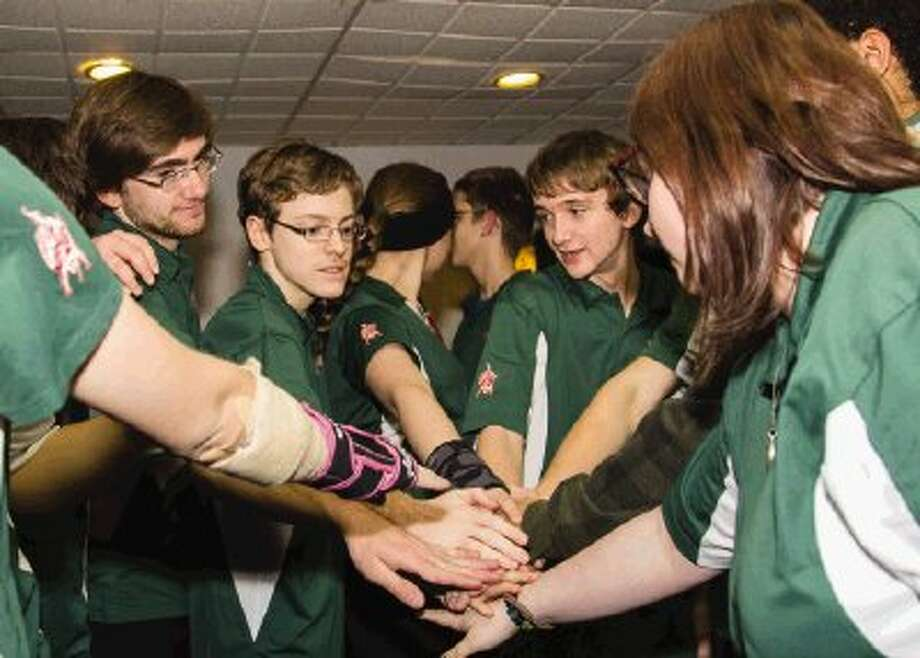 The Woodlands High School boys and girls bowling teams meet for a huddle before competing against Willis at 300 Bowling Center in Conroe on Friday. Photo: Ana Ramirez / The Conroe Courier/ The Woodland