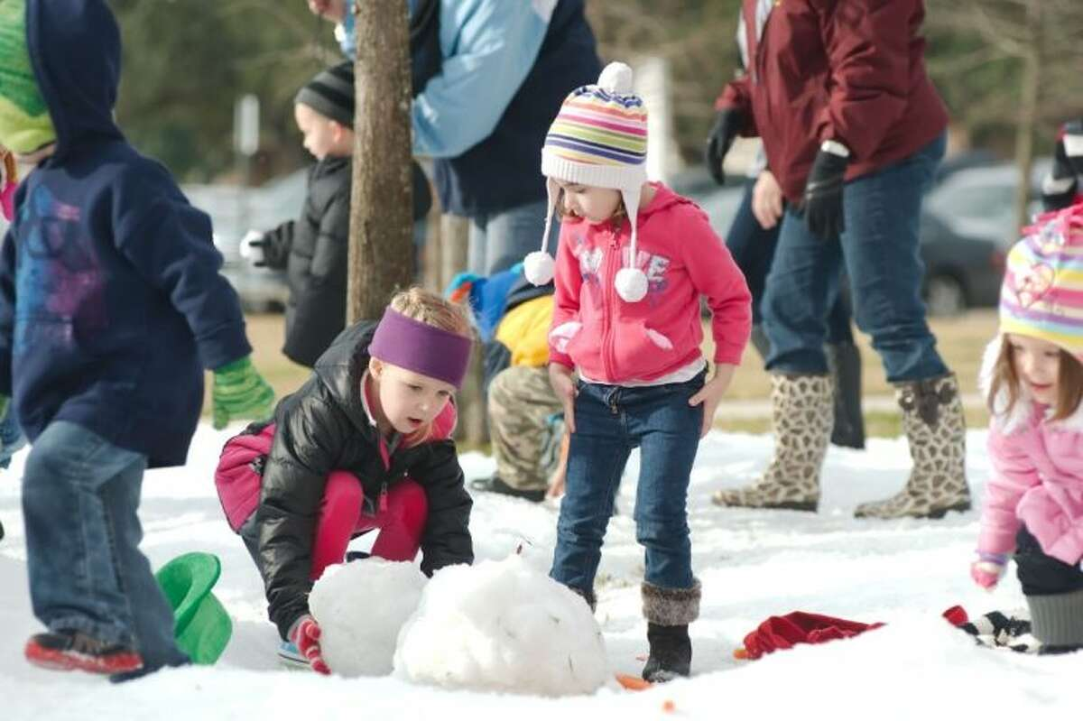 Leighton Fruin and Silvia Dickens build a snowman during the Deer Park Early Childhood Center Snow Day Thursday, Jan. 23.