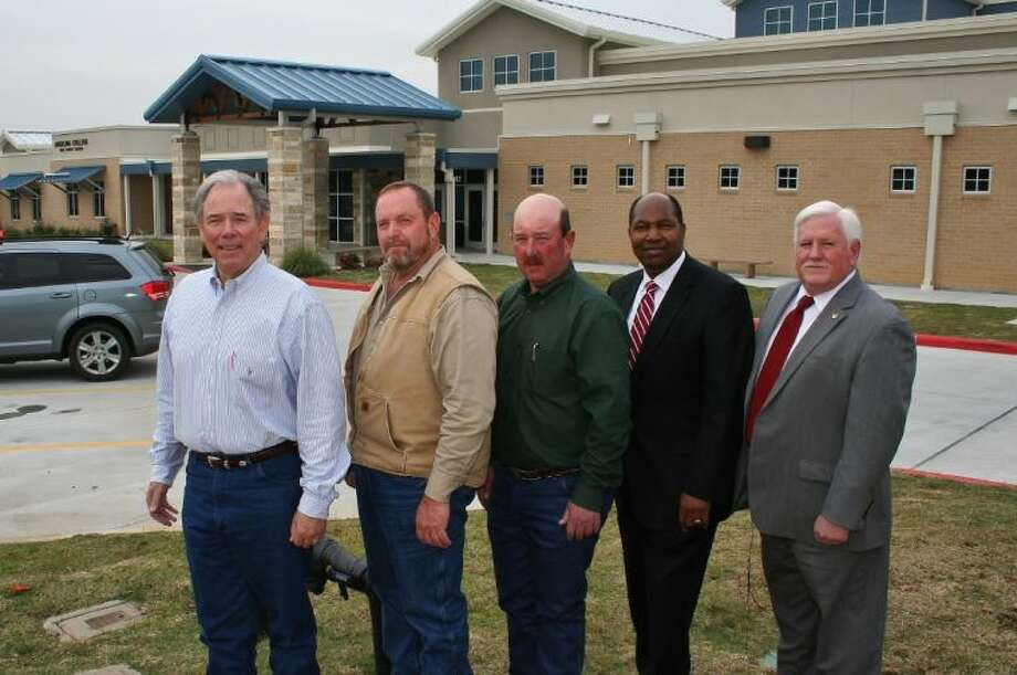 Polk County Judge John Thompson, Polk County Commissioners Milt Purvis and Tommy Overstreet, DETCOG Executive Director Walter Diggles and DETCOG President and Angelina County Judge Wes Suiter stand in front of the new Polk County Commerce Center. Photo: Submitted Photo