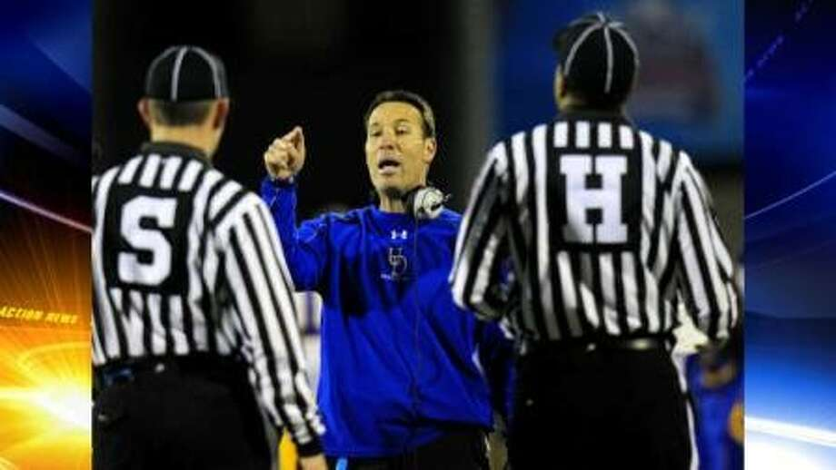 Delaware coach K. C. Keeler makes a point to game officials during the first half of the FCS championship game against Eastern Washington on Jan. 7, 2011, in Frisco. The Eagles scored 20 unanswered points in the second half to win 20-19.