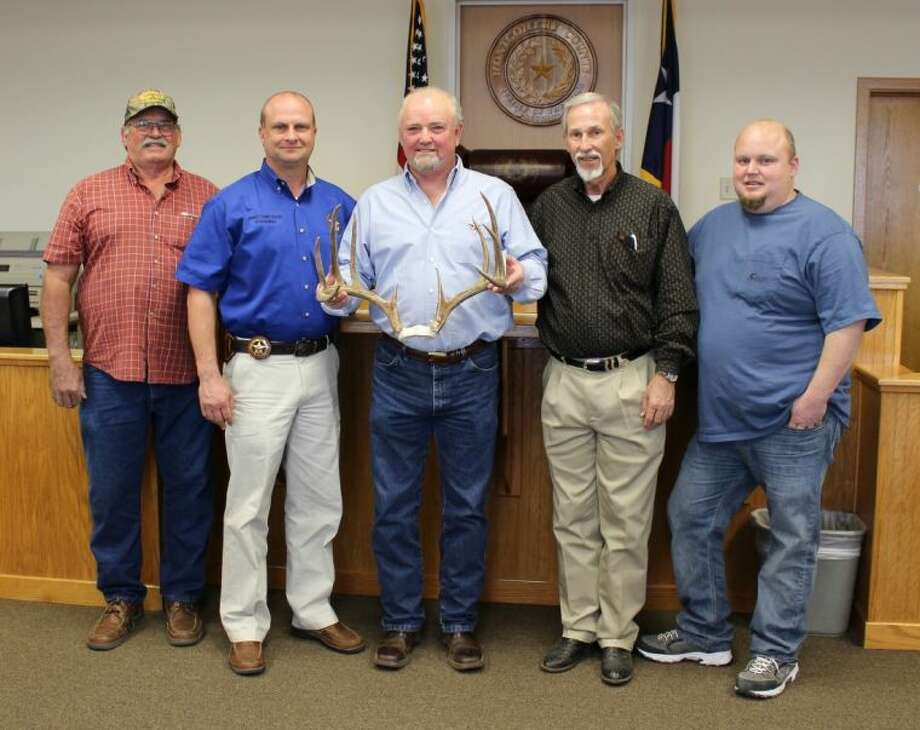 Larry Jackson (center) is the winner of the Biggest Buck contest sponsored by Montgomery County Pct. 4 Constable Rowdy Hayden (second from left) and Justice of the Peace James Metts (second from right). Also pictured are co-sponsors Wayne Sitton (far left) and Ricky Overall (far right). Photo: Submitted Photo