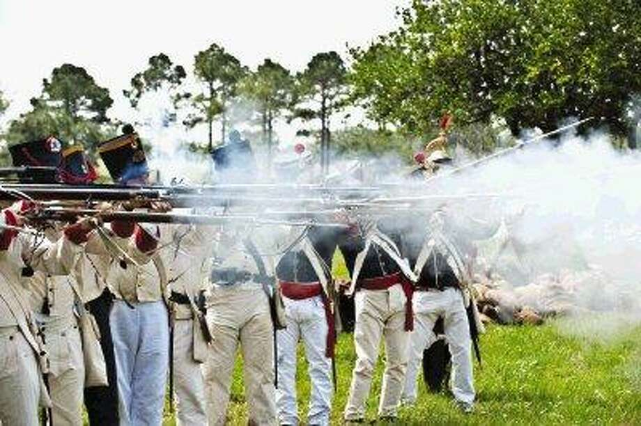The roar and smoke of gunfire fills the air as the Battle of San Jacinto is brought to life at the historic Battlegrounds. / TOM DORAN  ALL RIGHTS RESERVED
