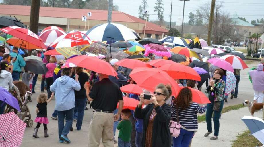 Participants in last year's dancing umbrella parade at Mardis Gras on the Stroll. This year's event is set for March 1 from 3-7 p.m. Photo: Submitted