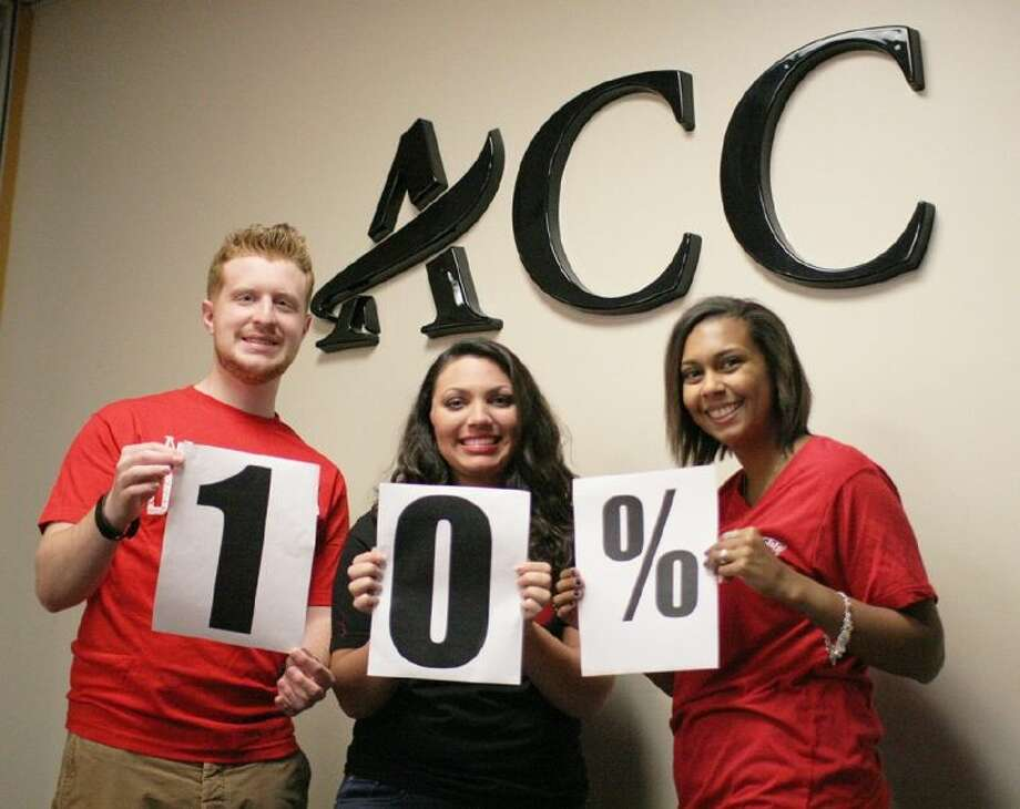 ACC students from left, Erik Hollen of Houston, Kayla Soliz of Alvin and Krista Weaver, of Alvin celebrate the announcement of the college being ranked as a top 10 percent community college by the Aspen Institute.