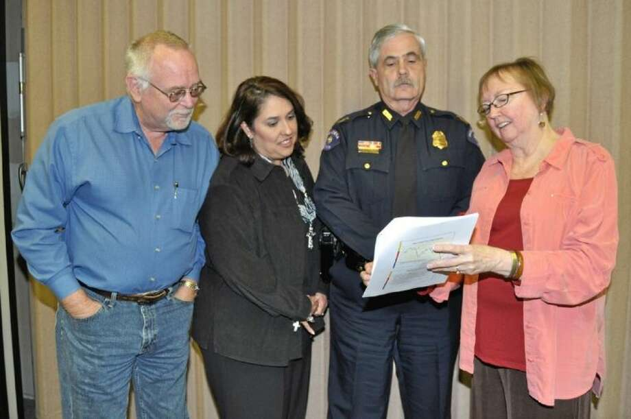 Pictured from left are Jim Bulger, BASF, Monica De La Portilla, Asst. Chief Mike Jackson and Diane Sheridan. Photo: JACKIE WELCH