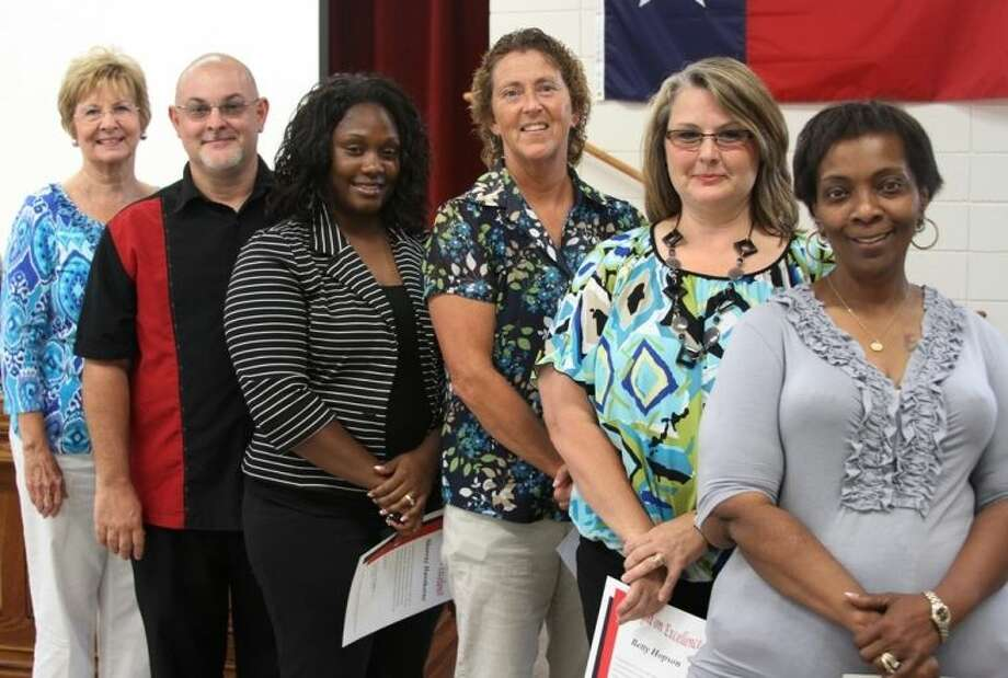 "COCISD's Spotlight on Excellence this month recognizes the following ""Bright Spots,"" faculty and staff members who regularly go above and beyond in the performance of their duties. Shown with COCISD Board President Barbara Moore, from left to right, are Peter Muller, Sherray Hawthorne, Rita Bass, Betty Hopson and Lulu Blanks. Not pictured are Thomas Kojak, Lt. Colonel Bradley Keane, Kristi Byrd and Tracy Blair. Photo: CASSIE GREGORY"