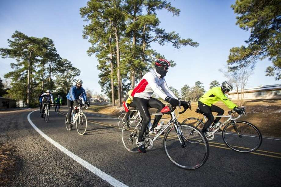 Cyclists make a turn during the Sixth Annual Bike Through the Forest and the Hills benefiting the Kingwood Fillies on Jan. 25, 2014, in Coldspring. Photo: ANDREW BUCKLEY