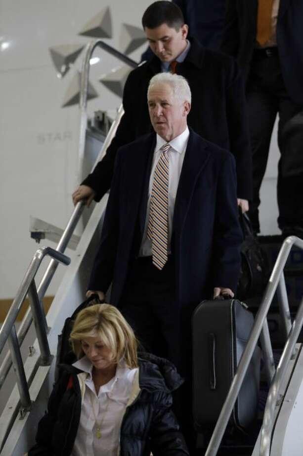 Broncos coach John Fox leaves the team plane in Newark, N.J.