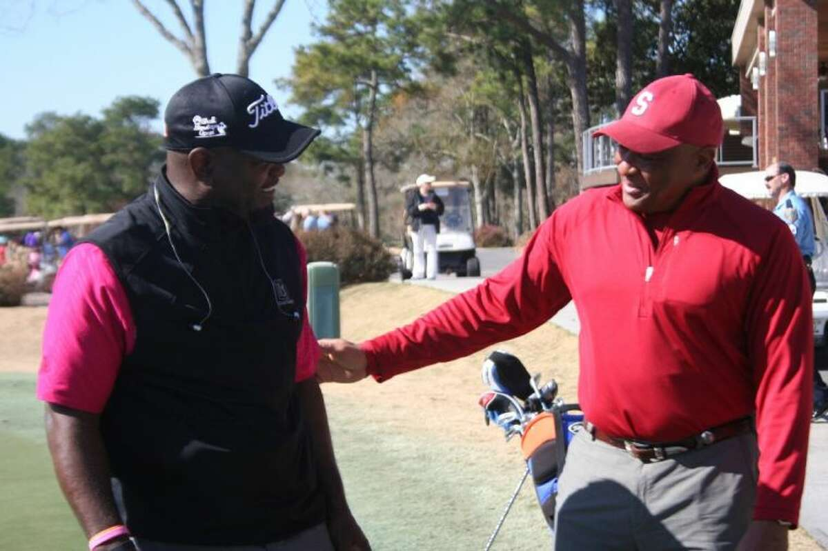 Emmitt Smith chats with golfers at his charity golf challenge held at the Clubs of Kingwood last Monday.