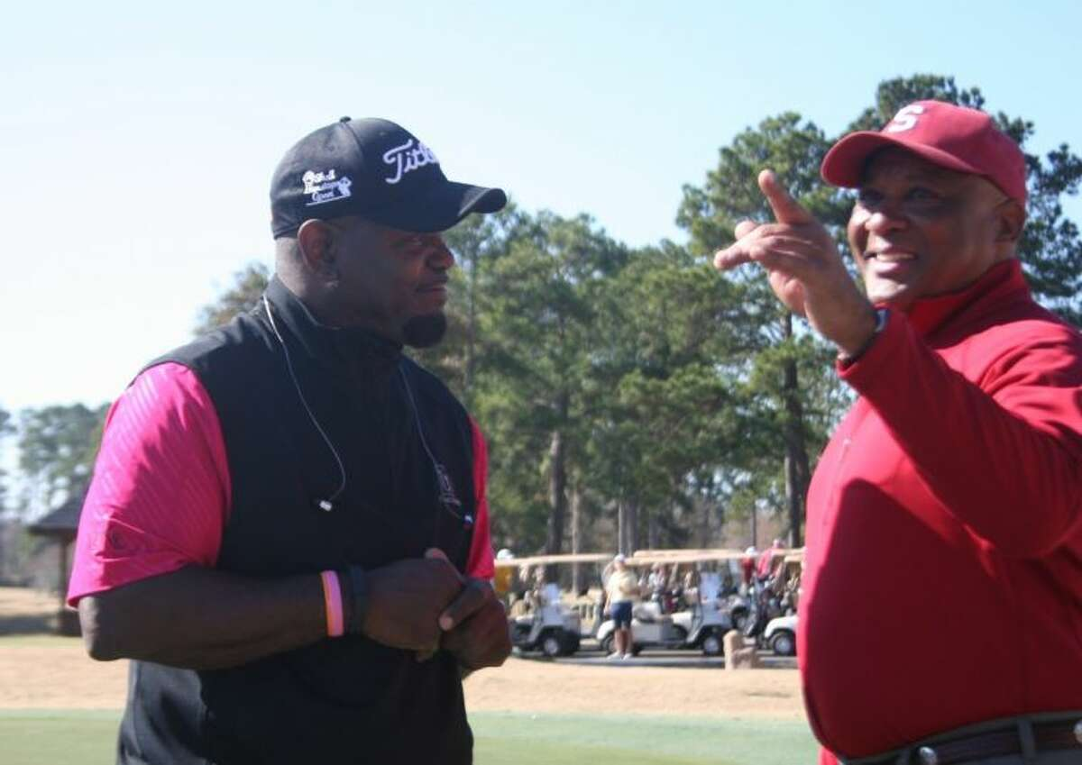 Emmitt Smith listens to stories from a golfer at the Clubs of Kingwood.