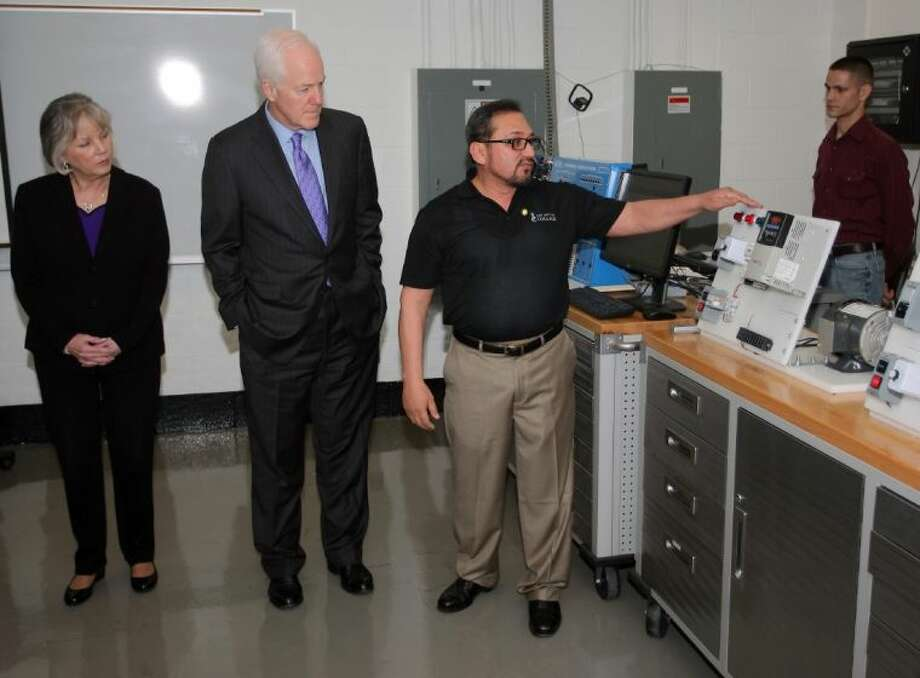 San Jacinto Instrumentation Technology Director Michael Duron demonstrates some of the equipment for Senator John Cornyn, his wife Sandy and guests during the tour. The Harris County job market has undergone a period of renaissance thanks to energy developments in shale gas and the recent shift in manufacturing to onshore production, Cornyn said. Photo: Kar B Hlava
