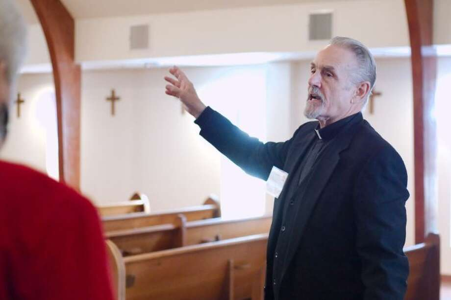 St. Paul's Anglican Church Rector Father Clay Shadeck leads a tour around his new church on Space Center Blvd. SaturdayJan. 25.
